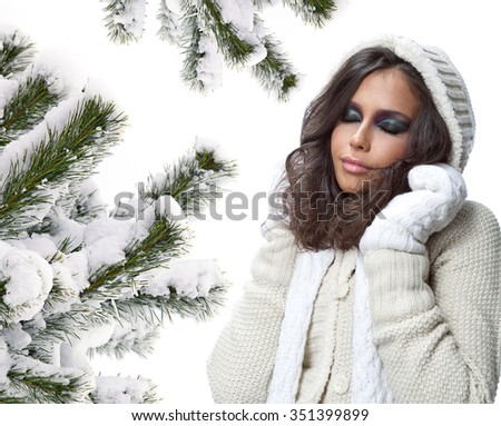 beauty face portrait of attractive young caucasian woman in warm clothing  studio shot isolated on white makeup winter christmas eyes closed christmas tree snow covered new year - stock photo