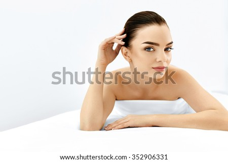 Beauty Face. Portrait Of Beautiful Smiling Model Woman Enjoying Her Perfect Fresh Clean Skin After Spa Treatment. Body And Skin Care, Cleansing And Moisturizing Concept. Healthy Lifestyle - stock photo
