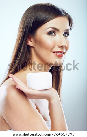 Beauty face portrait of woman holding jar cream. Isolated.