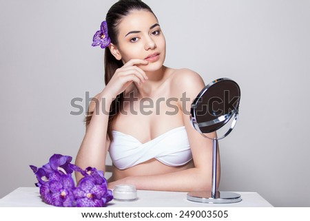Beauty face skin care woman sitting portrait of beautiful attractive young model - stock photo