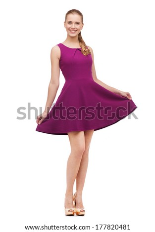 beauty, fashion and happy people concept - young woman in purple dress and high heels - stock photo