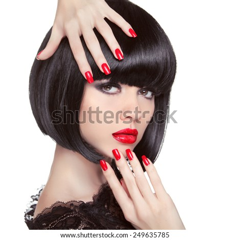 Beauty fashion brunette model portrait. Manicured nails. Red lips. Professional makeup. Bob hairstyle. Trendy girl isolated on white studio background. - stock photo