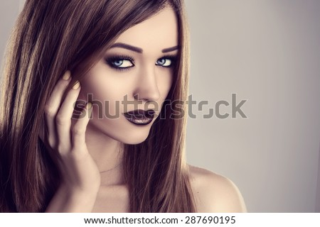 Beauty fashion brunette model woman portrait, vintage toned studio shot.