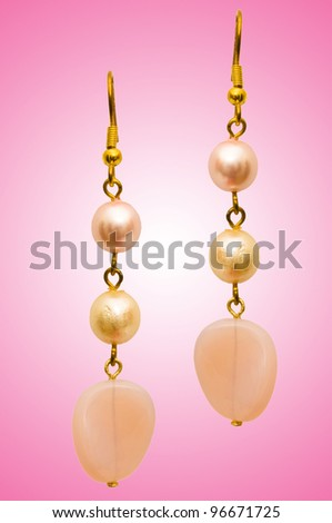 Beauty fashion concept with earrings - stock photo