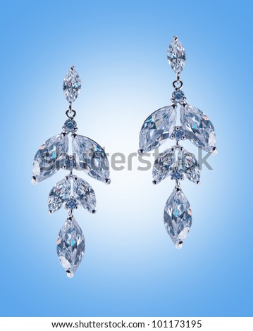 Beauty fashion concept with silver earrings - stock photo