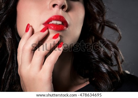 beauty fashion female face with red lips, red nails