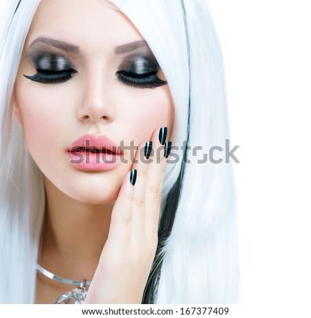 Beauty Fashion Girl black and white style. Long White Hair with Black Stripes. Smoky Eyes Makeup and Black short Nails. Sexy Woman Portrait. False Eyelashes  - stock photo