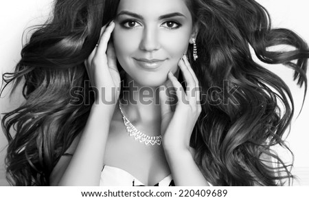 Beauty Fashion Girl Model Portrait. Long healthy Wavy hair. Professional makeup. Black and white photo - stock photo