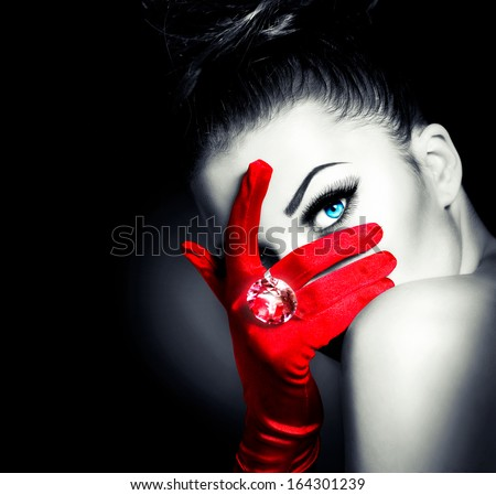 Beauty Fashion Glamorous Model Girl Portrait. Vintage Style Mysterious Woman Wearing Red Glamour Gloves. Jewellery. Jewelry. Holiday Hairstyle and Make-up. Diamond Ring. Retro Lady with Blue Eyes  - stock photo