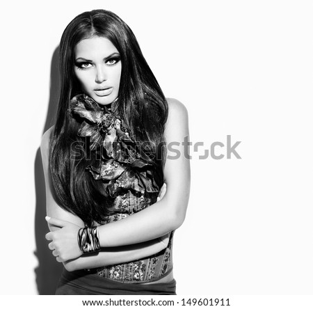 Beauty Fashion Model Girl Black and White  Portrait. Vogue Style Woman. Ling Healthy Hair and Beautiful Makeup. Trendy Wear - stock photo