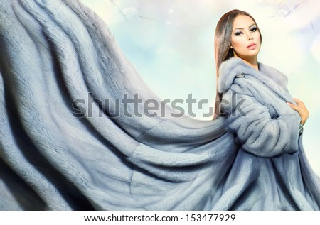Beauty Fashion Model Girl in Blue Mink Fur Coat. Beautiful Luxury Winter Woman  - stock photo