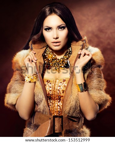 Beauty Fashion Model Girl in Fox Fur Coat. Beautiful Woman in Luxury Red Fur Jacket  - stock photo