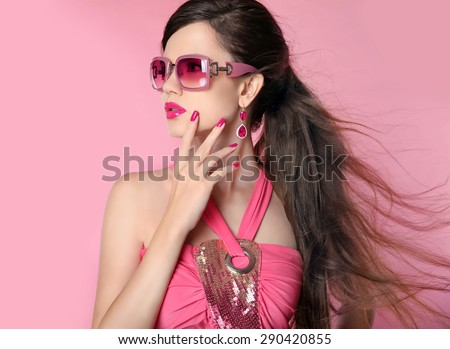 Beauty fashion model girl in sunglasses with bright makeup, long hair, manicured nails. Glamour woman isolated on pink studio background.  - stock photo