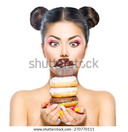 Beauty fashion model girl taking stack of colorful donuts and muffin. Funny joyful woman with sweets, dessert. Diet, dieting concept. Junk food, Slimming, weight loss. Isolated on white background - stock photo