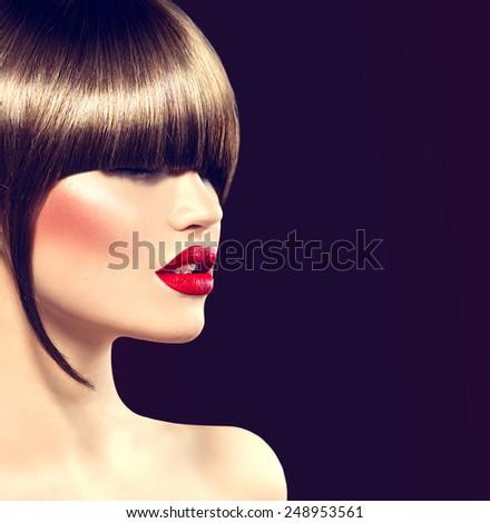 Beauty fashion model girl with glamour haircut, long fringe. Beautiful brunette woman face, perfect makeup, sexy red lips. Smooth brown hair. Make-up. Haircut. High Fashion Trendy Fringe Hair style - stock photo