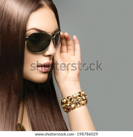 stylish sunglasses 2dms  Beauty Fashion model girl with long brown hair wearing stylish sunglasses  Sexy woman portrait