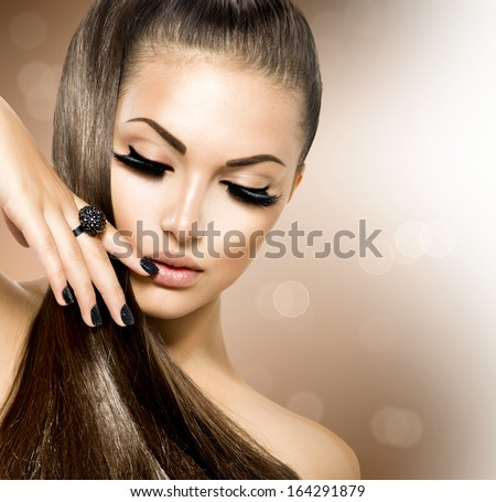 Beauty Fashion Model Girl with Long Healthy Brown Hair, Long Eyelashes. Fashion Trendy Caviar Black Manicure. Nail Art. Beautiful Stylish Woman with Healthy Smooth Skin. Ponytail. Perfect Makeup - stock photo