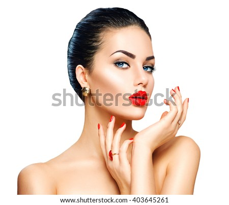 Beauty Fashion Model Woman face. Portrait with perfect skin. Red Lips and Nails. Beautiful Sexy Brunette Woman with Luxury Makeup and Manicure isolated on white background