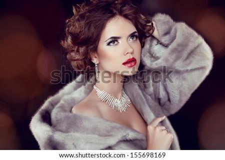 Beauty Fashion Model Woman in Mink Fur Coat. Winter Girl in Luxury Fur Coat and Diamond Jewelry Necklace  - stock photo