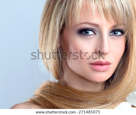 Beauty Fashion Portrait of Beautiful Seductive Young Woman looking at Camera.  - stock photo