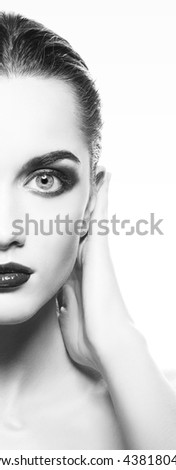 Beauty fashion portrait of caucasian brunette woman wet wet red lipstick and arms touching face. Isolated on white background. Black and white
