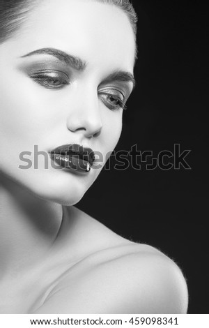 Beauty fashion portrait of caucasian brunette woman with wet red lipstick. Isolated on black background. Black and white - stock photo