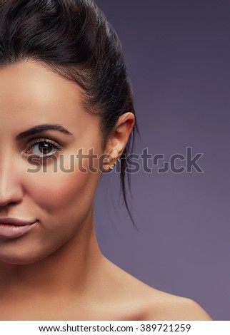 Beauty Fashion Portrait of Caucasian Young Girl with Natural Nude Make Up with brown eyes and shoulders on purple gradient background. Toned  - stock photo