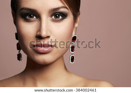 beauty fashion portrait of girl in jewelry. beautiful sexy woman with make-up - stock photo