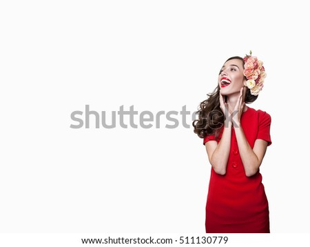 Beauty Fashion surprised Woman Portrait. Joyful woman. Beautiful Model Girl with Perfect make up exited, screaming and open and mouth. Headshot. Emotions. Isolated on a White Background. WOMAN IN RED