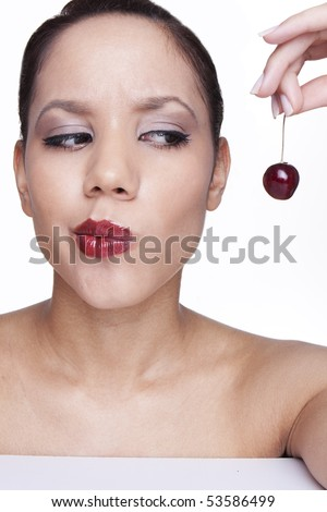 beauty female face with cherry thinking about to eat . - stock photo