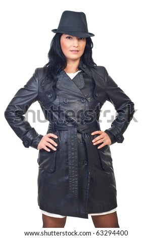Beauty female model in leather jacket and hat isolated on white background