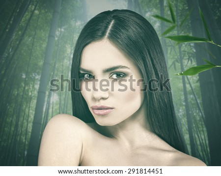 Beauty female portrait over bamboo forest as background