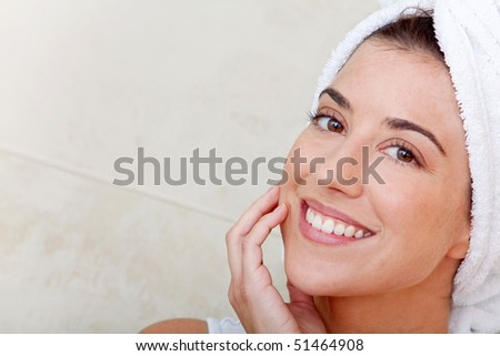 Beauty female portrait with a towel on her head - stock photo