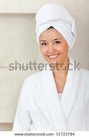 Beauty female portrait with a towel on her head