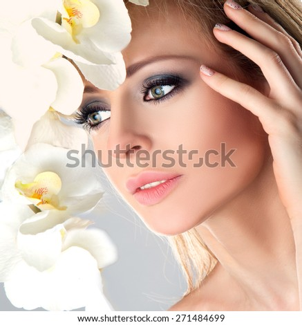Beauty Female Spa Face with White Orchid flower.  - stock photo