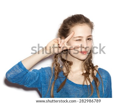 Beauty flirting smiling woman having fun. Portrait of teen girl beautiful cheerful enjoying with long brown hair and clean skin. Not isolated on white background - stock photo