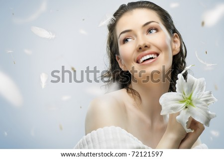beauty flower girl on the blue background - stock photo