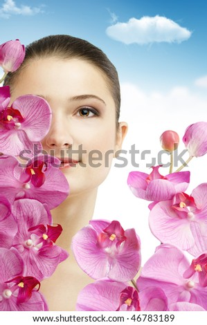 beauty flower girl on the sky background - stock photo