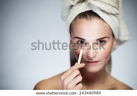 Beauty fresh model girl applying make up with cryon - stock photo