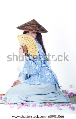 beauty geisha in blue kimono hide behind fan with hieroglyphs isolated on white background