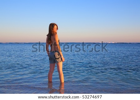 beauty girl at sea wave during sunset