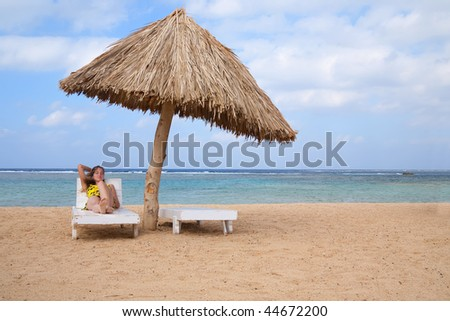 beauty girl  at the beach on a wooden deck