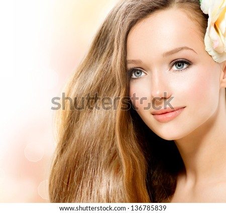 Beauty Girl. Beautiful Model Face. Healthy Long Hair and Perfect Clear Skin. Youth. Isolated on White Background. Skincare concept - stock photo