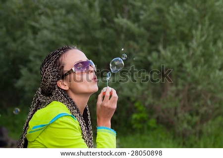 beauty girl belly soap bubbles on nature background