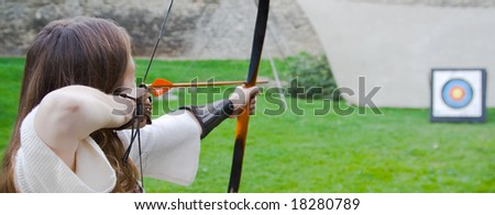Beauty girl bends bow archer target arrow - stock photo