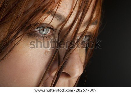 beauty girl cry on black background - stock photo