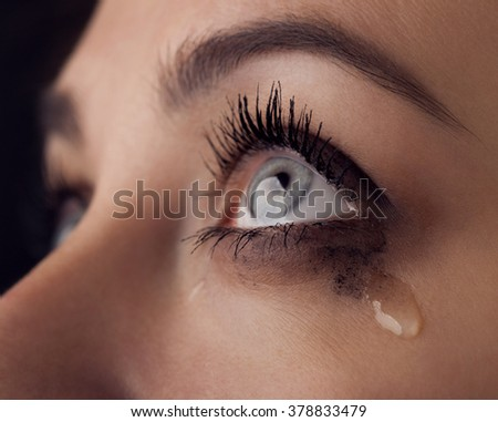 beauty girl cry on black background - stock photo