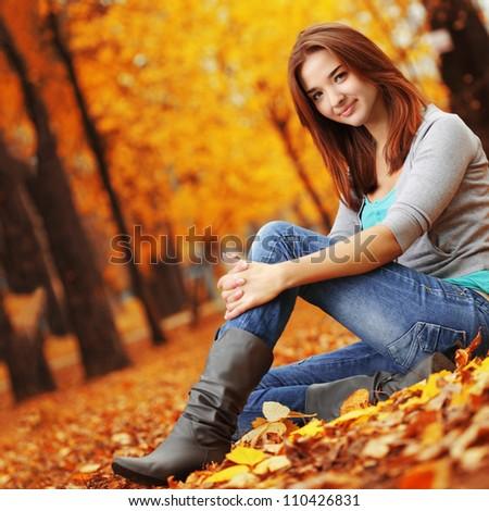beauty girl in autumn park - stock photo