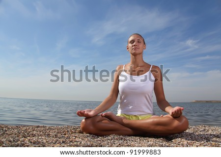beauty girl in lotus pose - stock photo