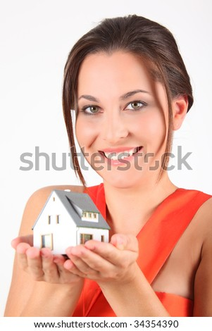 beauty girl in red dress with model of house